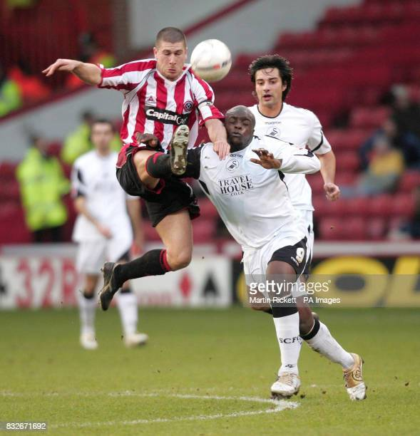 Swansea's Adebayo Akinfenwa challenges Sheffield United's Nick Montgomery during the FA Cup third round match at Bramhall Lane Sheffield