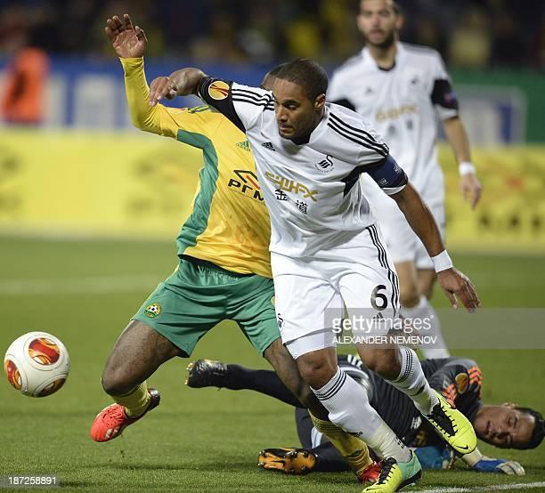 Swansea's forward Michu vies with Kuban's forward Djibril Cisse during their UEFA Europa League group second leg football match in Krasnodar on...