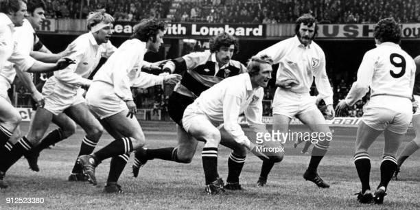 Swansea's Welsh international Phil Llewellyn feeds his scrum half, Huw Davies, 29th April 1978.