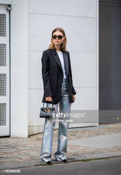 Swantje Sömmer is seen wearing black blazer Arket glitter pants Zara HM rip shirt lack mules Dorateymur Ray Ban sunglasses black Tory Burch bag on...