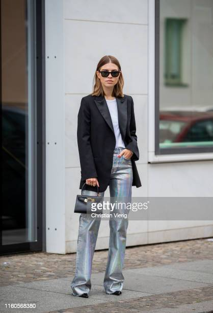 Swantje Sömmer is seen wearing black blazer Arket, glitter pants Zara, H&M rip shirt, lack mules Dorateymur, Ray Ban sunglasses, black Tory Burch bag...
