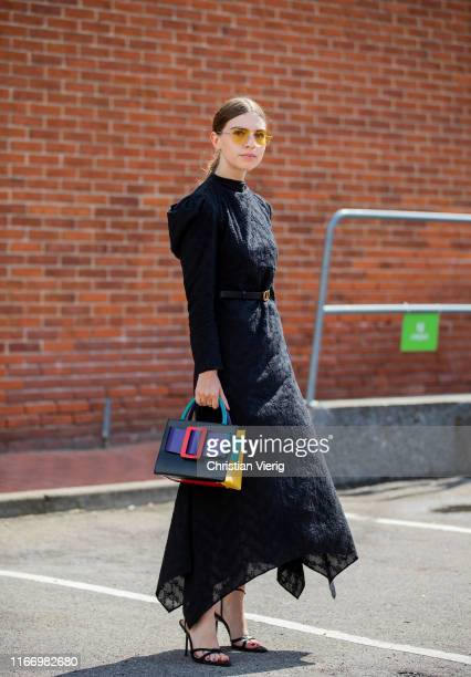 Swantje Sömmer is seen wearing black dress, multi colored Boyy bag outside By Malene Birger during Copenhagen Fashion Week Spring/Summer 2020 on...