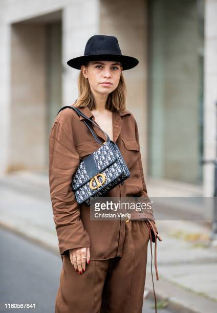 Swantje Sömmer is seen wearing brown button shirt and wide leg pants Zara, Dorothee Schumacher belt, Dior bag, Borsalino hat on July 06, 2019 in...