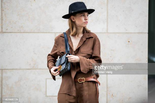 Swantje Sömmer is seen wearing brown button shirt and wide leg pants Zara Dorothee Schumacher belt Dior bag Borsalino hat on July 06 2019 in Berlin...