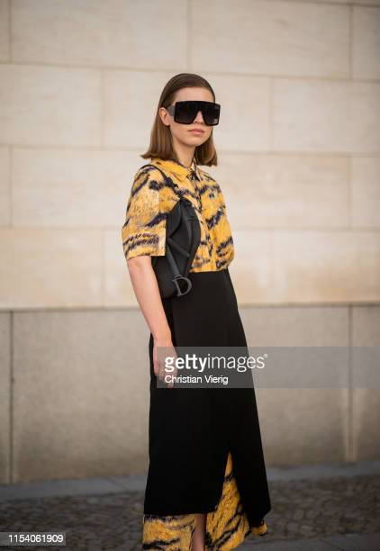 Swantje Sömmer is seen wearing button up dress with tiger print Hofmann Copenhagen black skirt with slit Aeron Dior sunglasses Dior saddle bag on...