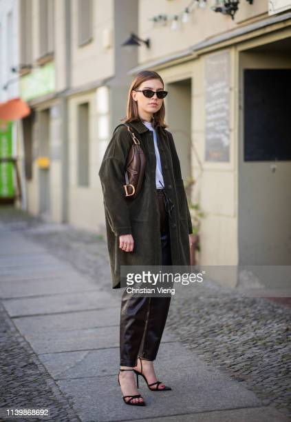 Swantje Sömmer is seen wearing corduroy button shirt Zara leather pants Mango Dior saddle bag Zara heels Rayban sunglasses on April 01 2019 in Berlin...