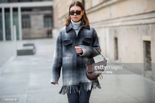 Swantje Sömmer is seen wearing grey cashmere turtleneck Boden white grey jacket with fringest Alexander Wang dark denim skinny jeans HM Rayban...