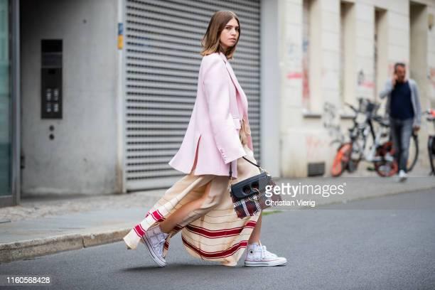 Swantje Sömmer is seen wearing pink blazer Joseph wide leg pants with slit Zara JW Anderson x Converse chucks JW Anderson bag on July 06 2019 in...