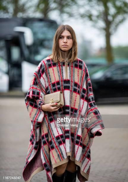Swantje Sömmer is seen wearing plaid cape outside Munthe during Copenhagen Fashion Week Spring/Summer 2020 on August 07, 2019 in Copenhagen, Denmark.