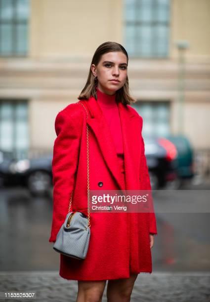 Swantje Sömmer is seen wearing red turtleneck coat grey bag skirt Marx Mara outside Max Mara Resort 2020 on June 03 2019 in Berlin Germany