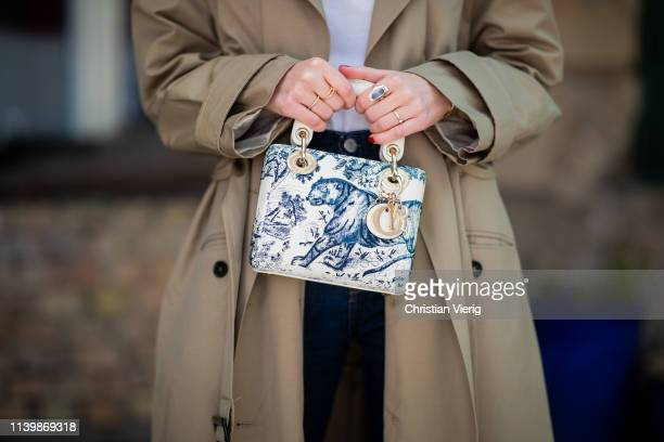 Swantje Sömmer is seen wearing trench coat DAY Calvin Klein jeans Dior bag on April 01 2019 in Berlin Germany