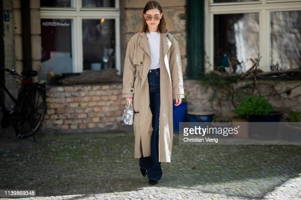 Swantje Sömmer is seen wearing trench coat DAY Calvin Klein jeans Dior bag black mules Dorateymur Miu Miu sunglasses on April 01 2019 in Berlin...