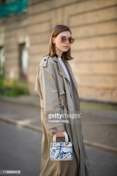 Swantje Sömmer is seen wearing trench coat DAY Calvin Klein jeans Dior bag Miu Miu sunglasses on April 01 2019 in Berlin Germany