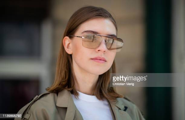 Swantje Sömmer is seen wearing trench coat DAY Miu Miu sunglasses on April 01 2019 in Berlin Germany