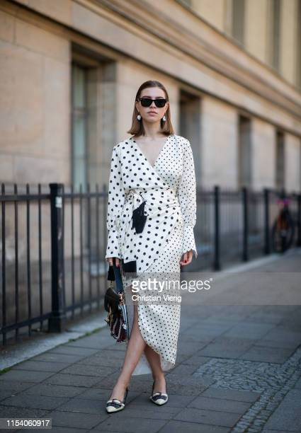 Swantje Sömmer is seen wearing white dress with black dots print Mother of Pearl JW Anderson plaid bag Prada shoes in black and white Ray Ban...