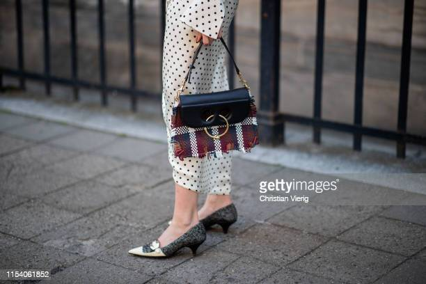 Swantje Sömmer is seen wearing white dress with black dots print Mother of Pearl JW Anderson plaid bag Prada shoes in black and white on June 05 2019...