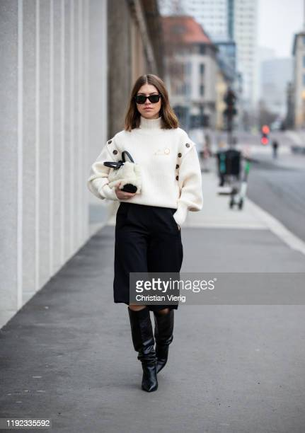 Swantje Sömmer is seen wearing white turtleneck knit HM brooch Loewe vintage culottes bemuda Longchamp bag black Mango boots Rayban sunglasses on...