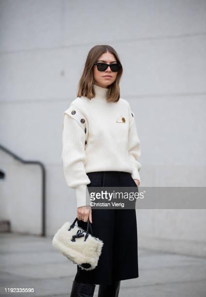 Swantje Sömmer is seen wearing white turtleneck knit H&M, brooch Loewe, vintage culottes bemuda, Longchamp bag, black Mango boots, Rayban sunglasses...