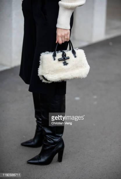 Swantje Sömmer is seen wearing white turtleneck knit HM vintage culottes bemuda Longchamp bag black Mango boots on December 06 2019 in Berlin Germany