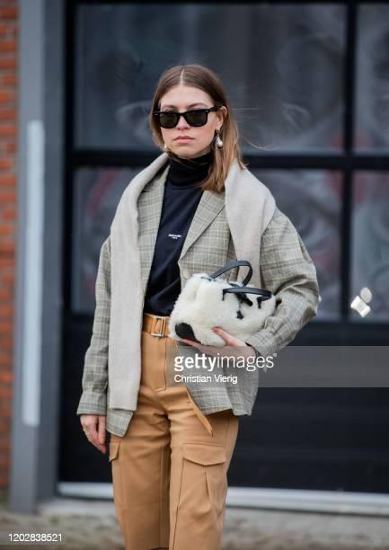 Swantje Sömmer seen wearing beige cropped pants, checkered blazer, black boots outside Holzweiler during Copenhagen Fashion Week Autumn/Winter 2020...