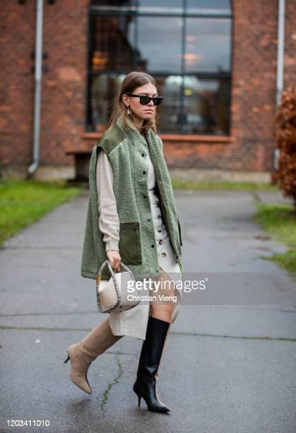 Swantje Sömmer seen wearing green sleeveless jacket, dress, two tone boots outside Baum und Pferdgarten during Copenhagen Fashion Week Autumn/Winter...