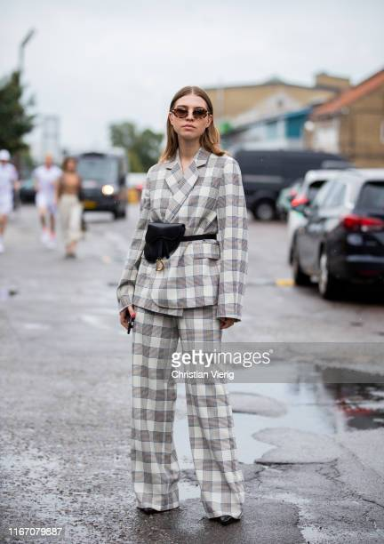 Swantje Sömmer seen wearing plaid suit Dior saddle bag worn as fanny bag outside Baum und Pferdgarten during Copenhagen Fashion Week Spring/Summer...