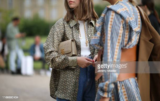 Swantje Soemmer and Aylin Koeing wearing Burberry bag and shirt on August 07, 2019 in Copenhagen, Denmark.