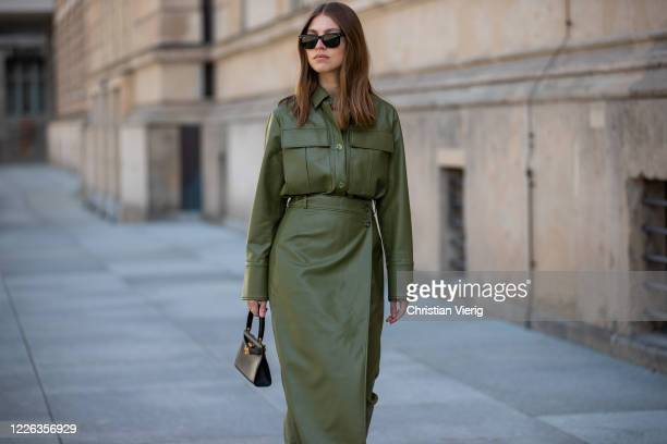 Swantje Soemmer is seen green leather skirt and button shirt Aeron black Tory Burch bag Ray Ban sunglasses on May 21 2020 in Berlin Germany