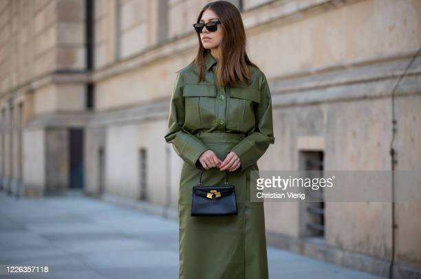 Swantje Soemmer is seen green leather skirt and button shirt Aeron, black Tory Burch bag, Ray Ban sunglasses on May 21, 2020 in Berlin, Germany.