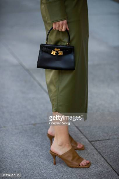 Swantje Soemmer is seen green leather skirt and button shirt Aeron brown mules Zara black Tory Burch bag on May 21 2020 in Berlin Germany