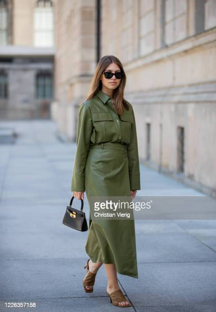 Swantje Soemmer is seen green leather skirt and button shirt Aeron brown mules Zara black Tory Burch bag Ray Ban sunglasses on May 21 2020 in Berlin...