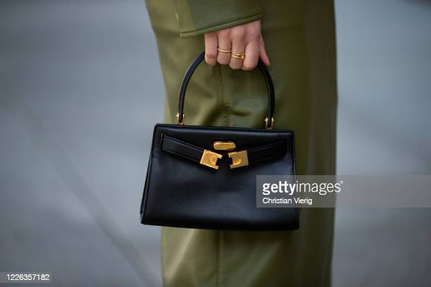 Swantje Soemmer is seen green leather skirt and button shirt Aeron black Tory Burch bag on May 21 2020 in Berlin Germany