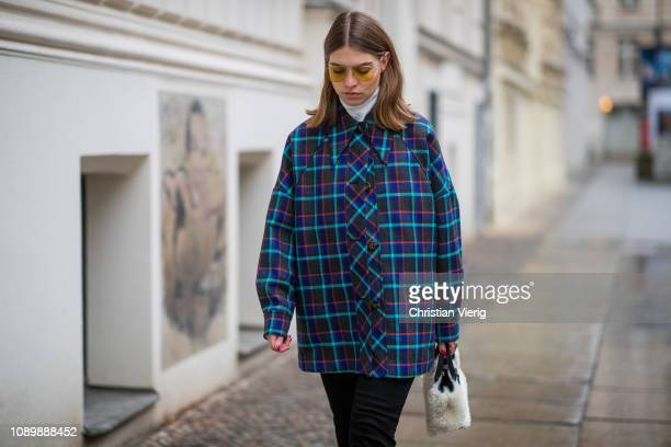 Swantje Soemmer is seen wearing blue checked Missoni jacket black ripped denim jeans Boden Marc Jacobs sunglasses AGL cowboy boots Longchamp bag on...