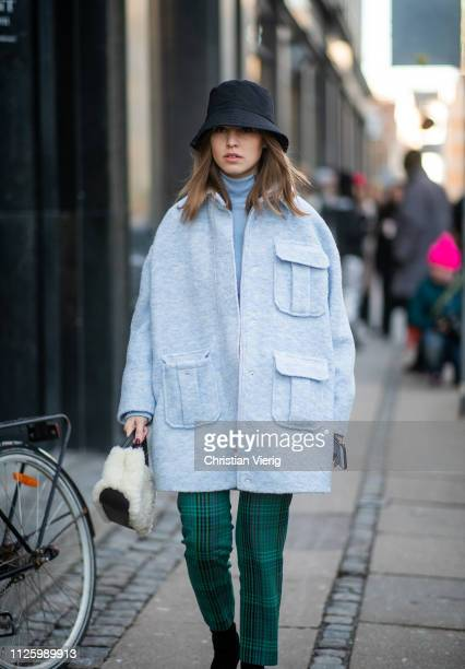 Swantje Soemmer is seen wearing bucket hat blue coat fake faux bag cropped green pants outside Mykke Hofmann during the Copenhagen Fashion Week...