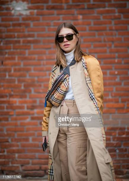 Swantje Soemmer is seen wearing Burberry fanny bag beige high waist pants two tone trench coat white turtleneck outside Munthe during the Copenhagen...