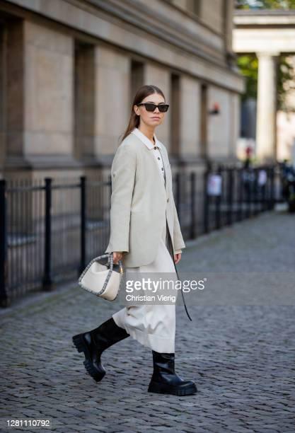 Swantje Soemmer is seen wearing creme white Blazer - Arket, knitted dress Zara, black boots - Zara, white bag Boyy, sunglasses - Chanel, black belt -...