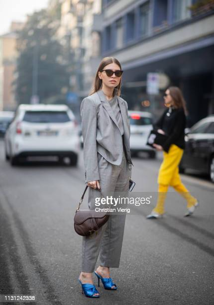 Swantje Soemmer is seen wearing greyy suit Dior saddle bag blue heels outside Max Mara on Day 2 Milan Fashion Week Autumn/Winter 2019/20 on February...