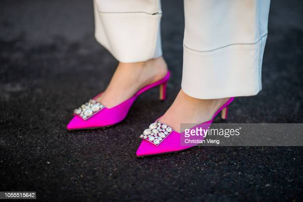 Swantje Soemmer is seen wearing neon turtleneck knit Zara white high waist pants Sportmax brown Dior saddle bag pink Paul Andrew slingbacks shoes on...