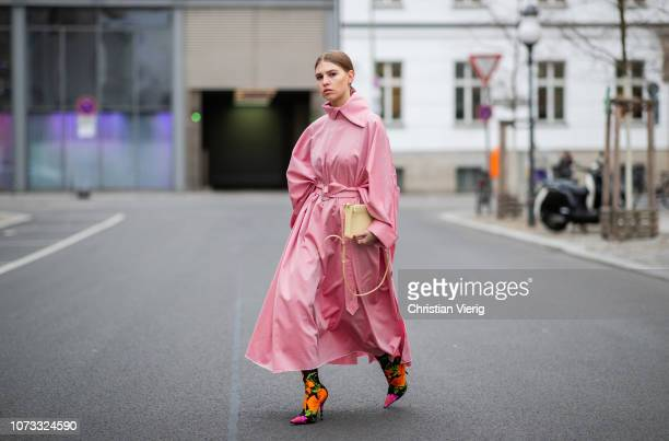 Swantje Soemmer is seen wearing pink belted coat Marques Almeida Celine bag Balenciaga sock boots with floral print on December 14 2018 in Berlin...