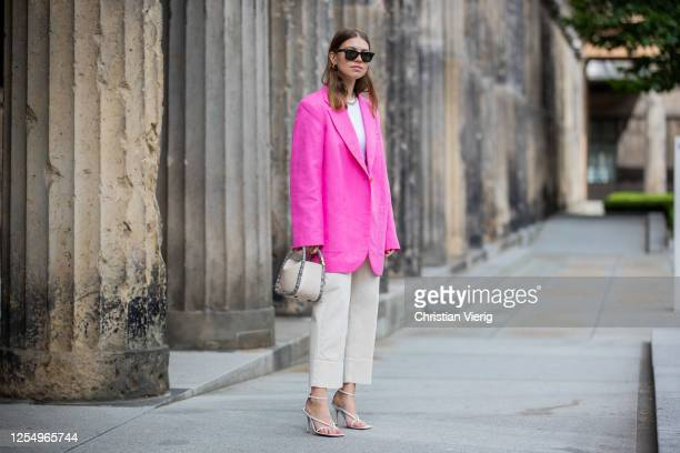Swantje Soemmer is seen wearing pink blazer Arket white pants Luisa Cerano Boyy bag Malaika Raiss necklace Bottega Veneta heels Rayban sunglasses on...