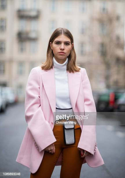 Swantje Soemmer is seen wearing pink Joseph blazer Marc Cain turtleneck Miu Miu belt bag orange flared Gestuz pants Longchamp sandals on January 04...