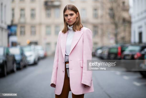 Swantje Soemmer is seen wearing pink Joseph blazer Miu Miu belt bag and orange flared Gestuz pants on January 04 2019 in Berlin Germany