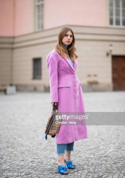 Swantje Soemmer is seen wearing pink Philipp Lim wool coat Marc Cain knit Closed denim jeans Burberry belt bag No21 heels on December 14 2018 in...
