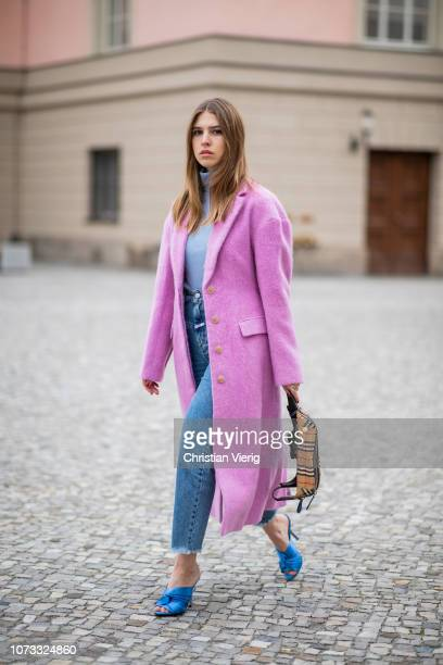 Swantje Soemmer is seen wearing pink Philipp Lim wool coat Marc Cain knit Closed denim jeans Burberry belt bag No21 heels on December 14 2018 in...