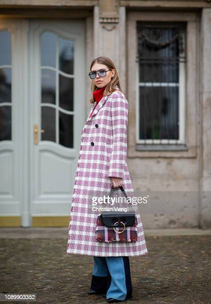 Swantje Soemmer is seen wearing red white checked Dorothee Schumacher coat red Aeron turtleneck flared patched two tone denim jeans Victoria Beckham...