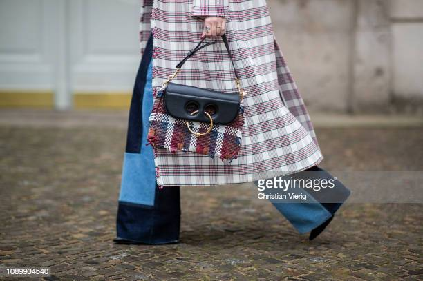Swantje Soemmer is seen wearing red white checked Dorothee Schumacher coat flared patched two tone denim jeans Victoria Beckham JW Anderson bag and...