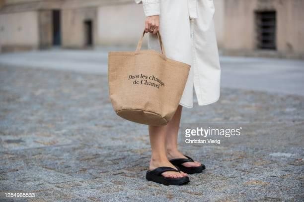 Swantje Soemmer is seen wearing white dress Blanche, Arket plateau flip flops, Chanel beach bag on July 07, 2020 in Berlin, Germany.