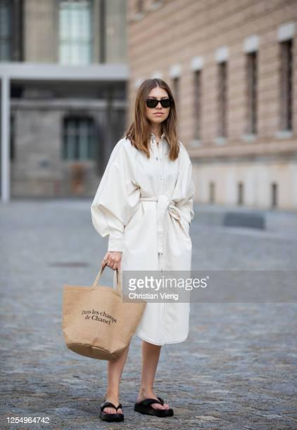 Swantje Soemmer is seen wearing white dress Blanche, Rayban sunglasses, Arket plateau flip flops, Chanel beach bag on July 07, 2020 in Berlin,...