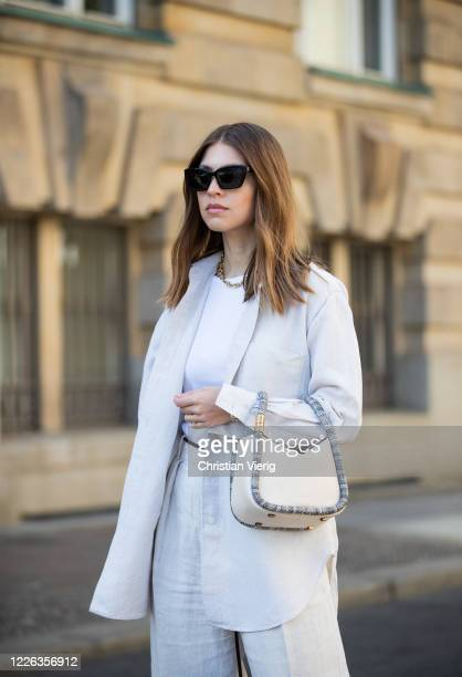 Swantje Soemmer is seen wearing white linen shirt and pants Arket white boyy bag sunglasses Ray Ban on May 21 2020 in Berlin Germany