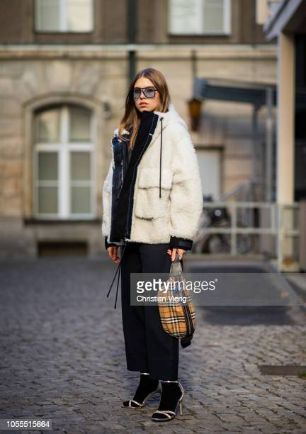 Swantje Soemmer is seen wearing white teddy jacket Sportmax black pants Sportmax Burberry belt bag Steve Madden heels in socks Orgreen sunglasses on...